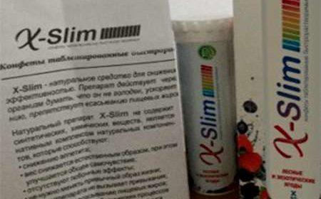 Таблетки X Slim, их упаковка и инструкция к применению на столе